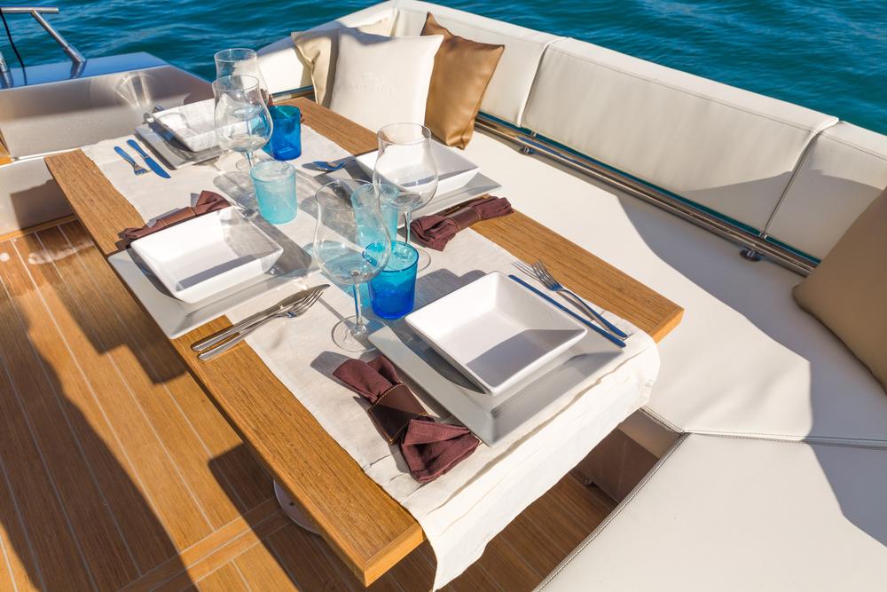 Table setting on teak deck